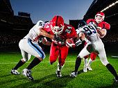 Football running back running through defendersh