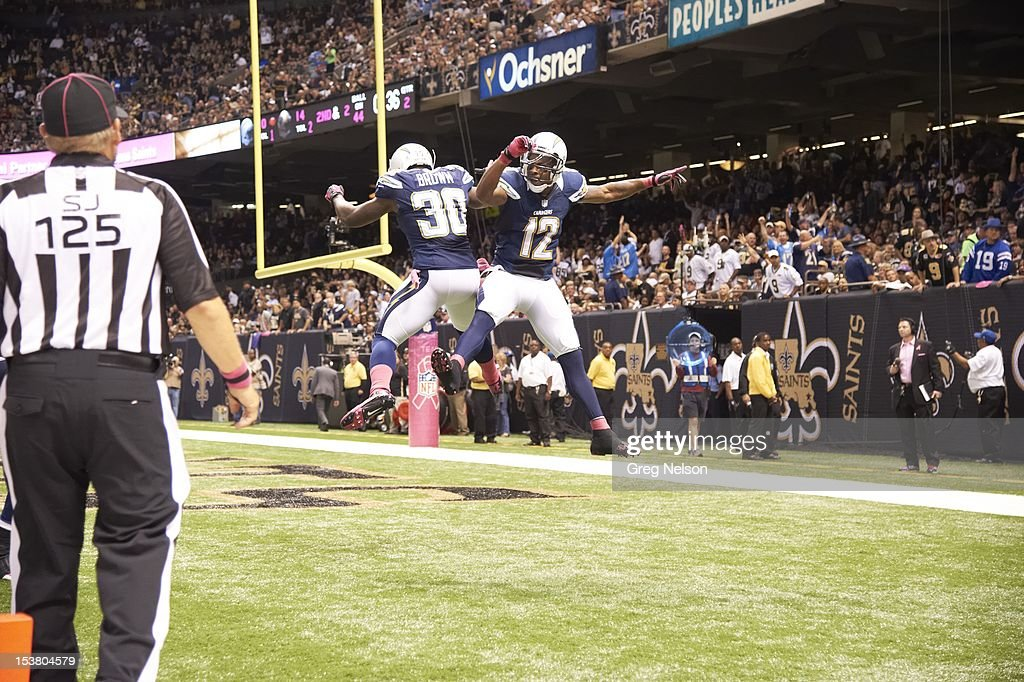 San Diego Chargers Ronnie Brown (30) and Robert Meachem (12) victorious during game vs New Orleans Saints at Mercedes-Benz Superdome. Greg Nelson F76 )