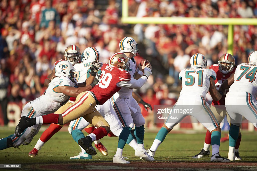 San Francisco 49ers Aldon Smith (99) in action, defense vs Miami Dolphins QB Ryan Tannehill (17) at Candlestick Park. Robert Beck F335 )