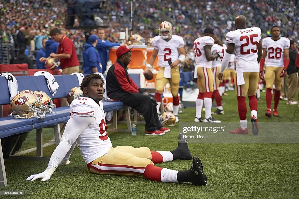 San Francisco 49ers Aldon Smith (99) seated on sidelines during game vs Seattle Seahawks at CenturyLink Field. Robert Beck F71 )
