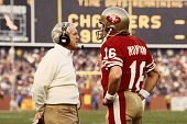 Football San Francisco 49ers coach Bill Walsh with QB Joe Montana on sidelines during game vs San Diego Chargers San Francisco CA