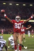 Football San Francisco 49ers Jerry Rice victorious after scoring 127th career TD breaking Jim Brown record during game vs Los Angeles Raiders San...