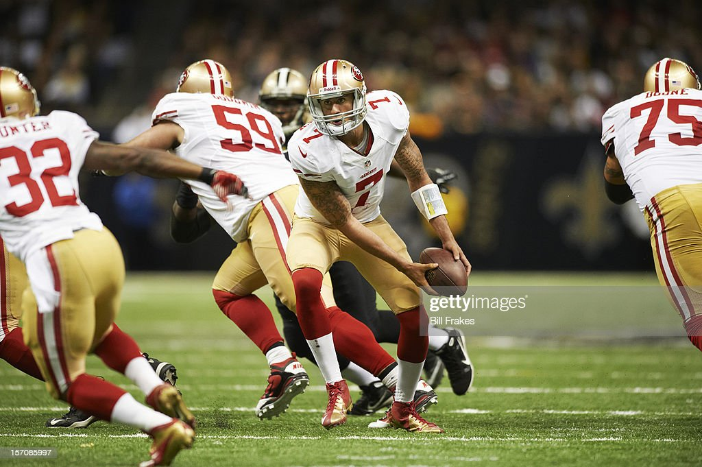 San Francisco 49ers QB Colin Kaepernick (7) in action, making pitch vs New Orleans Saints at Mercedes-Benz Superdome. Bill Frakes F105 )