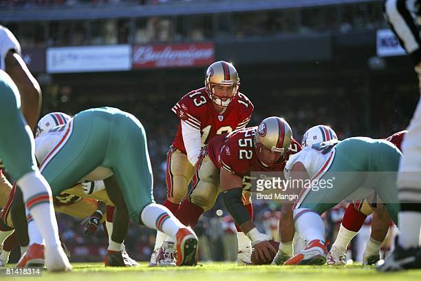 Football San Francisco 49ers QB Tim Rattay and Brock Gutierrez at line of scrimmage before snap vs Miami Dolphins San Francisco CA