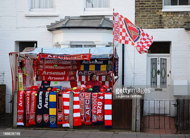 Football scarfs are sold on a temporary street stall ahead of the Barclays Premier League match between Arsenal and Liverpool at Emirates Stadium on...
