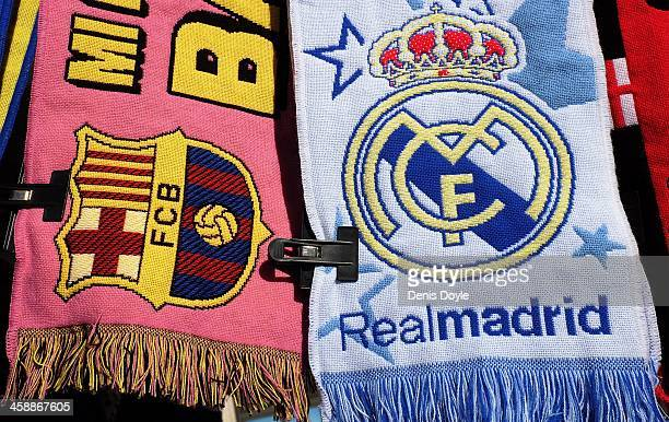 Football scarves displaying the emblems of FC Barcelona and Real Madrid are sold on a stall on December 22 2013 in Madrid Spain The European Union...