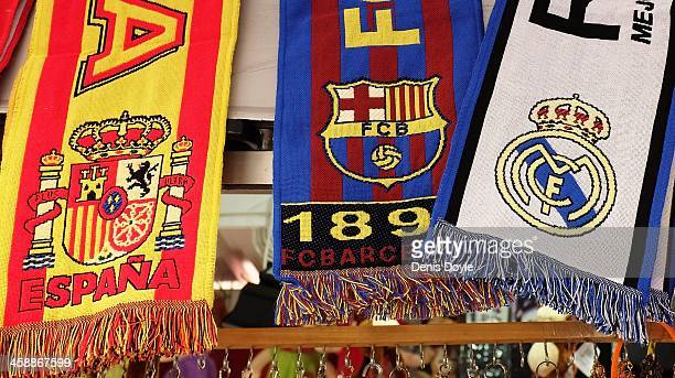Football scarves displaying the emblems of Spain FC Barcelona and Real Madrid are sold on a stall on December 22 2013 in Madrid Spain The European...