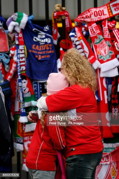Football scarves from all over the world are tied to the Shankly Gates next to the Hillsborough Memorial in Liverpool