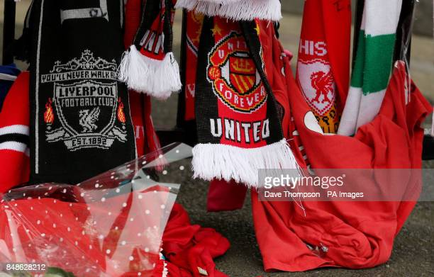 Football scarves hangs alongside Liverpool FC scarves on the Shankly Gates next to the Hillsborough Memorial at Liverpool's Anfield Stadium The...