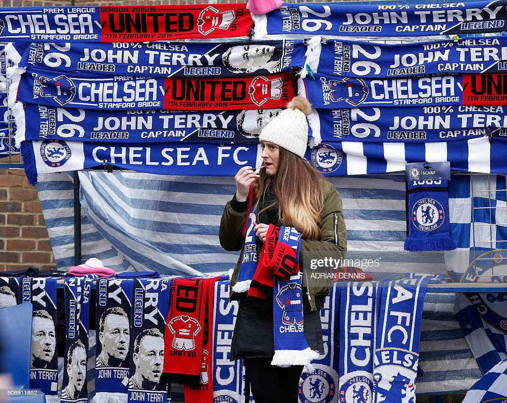 Football scarves on sale before the English Premier League football match between Chelsea and Manchester United at Stamford Bridge in London on on February 7, 2016. / AFP / ADRIAN DENNIS / RESTRICTED TO EDITORIAL USE. No use with unauthorized audio, video, data, fixture lists, club/league logos or 'live' services. Online in-match use limited to 75 images, no video emulation. No use in betting, games or single club/league/player publications. /