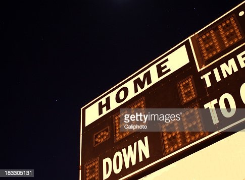 Football scoreboard with no numbers on it in the dark