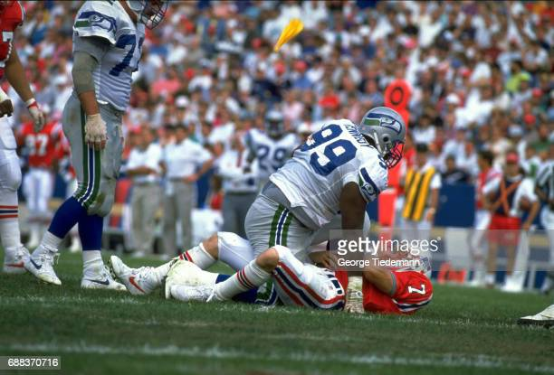 Seattle Seahawks Cortez Kennedy in action vs New England Patriots QB Hugh Millen at Foxboro Stadium Foxborough MA CREDIT George Tiedemann