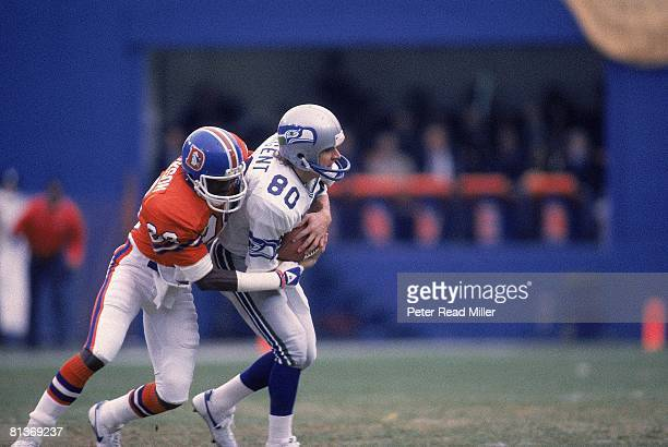 Football Seattle Seahawks Steve Largent in action vs Denver Broncos Robert Jackson Denver CO