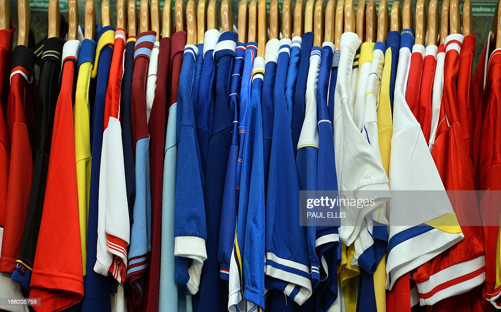 Football shirts are displayed during the Soccerex European Forum in Manchester, north-west England on April 10, 2013. Soccerex is a football business event, conference and exhibition. AFP PHOTO/PAUL ELLIS