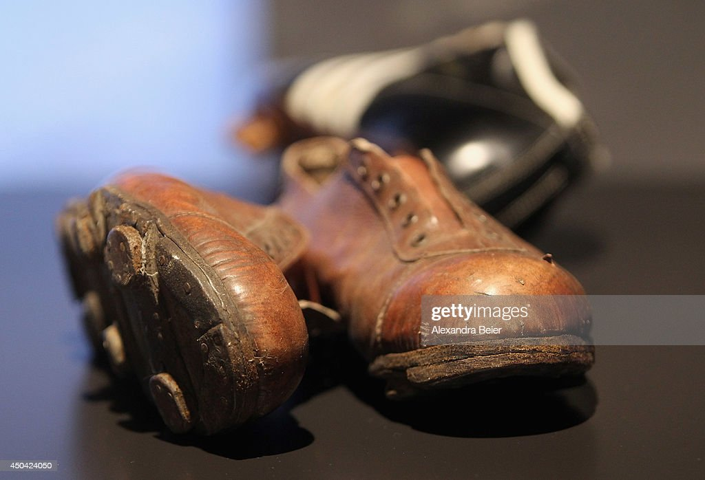 Football shoes as played in the World Cup 1954 are pictured during the opening day of a World Cup 1954 exhibition at Allianz Arena Erlebniswelt museum on June 11, 2014 in Munich, Germany.