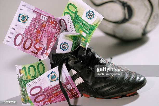 Football shoes filled with money