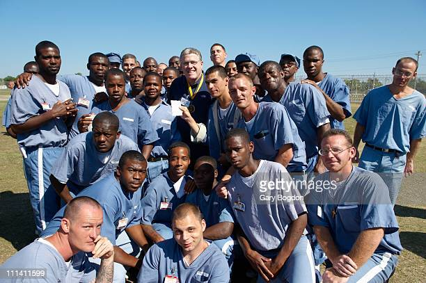 SI Senior Writer Peter King prison inmates during visit by Philadelphia Eagles QB Michael Vick to Avon Park Correctional Institute Vick served 21...