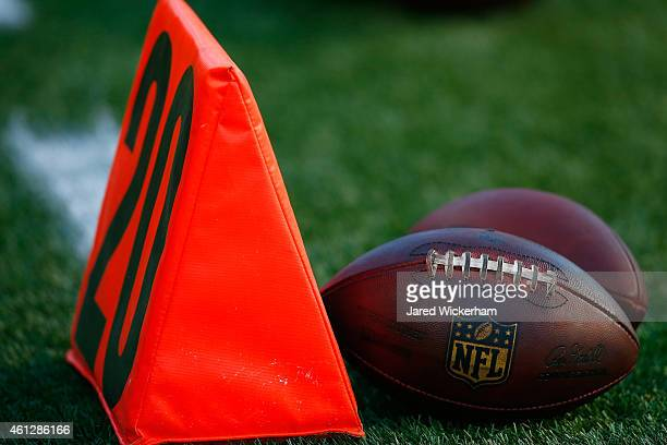 A football sits next turnover the 20 yard line marker before the 2014 AFC Divisional Playoffs game between the Baltimore Ravens and the New England...