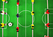 Football soccer World Cup banner. Yellow, red and blue players on metal rods are on green field lawn with big ball. Sport game and recreations for kids and adults