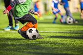 Football soccer training for children. boys playing football game.