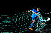 Football/ soccerplayer with lighttrace