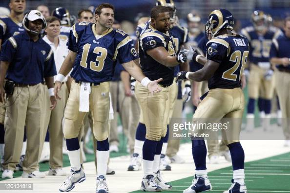 St Louis Rams Marshall Faulk victorious during game with Kurt Warner and Tyoka Jackson during game vs San Francisco 49ers at Edward Jones DomeSt...