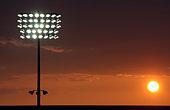 Football stadium lights at sunset