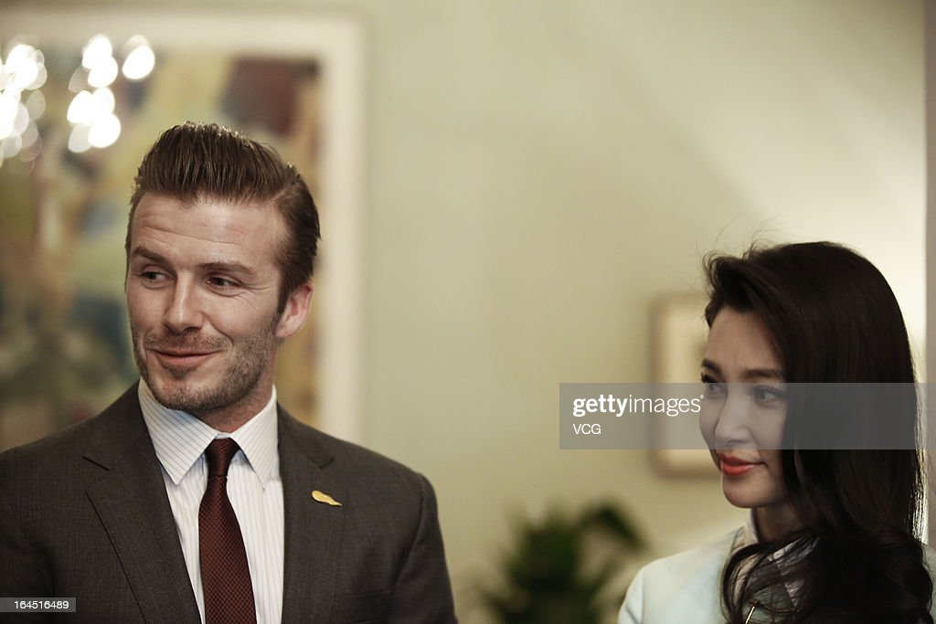 Football star <a gi-track='captionPersonalityLinkClicked' href=/galleries/search?phrase=David+Beckham&family=editorial&specificpeople=158480 ng-click='$event.stopPropagation()'>David Beckham</a> and Chinese actress <a gi-track='captionPersonalityLinkClicked' href=/galleries/search?phrase=Li+Bingbing&family=editorial&specificpeople=697017 ng-click='$event.stopPropagation()'>Li Bingbing</a> visit the British Embassy on March 24, 2013 in Beijing, China.