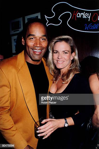 Football star turned actor OJ Simpson w his arm around wife Nicole at the opening of the Harley Davidson Cafe