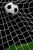 Football striking on net, close up