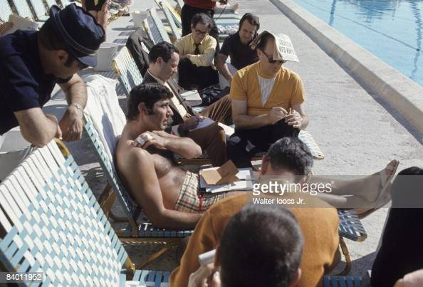 Super Bowl Casual portrait of New York Jets QB Joe Namath sitting on pool chair surrounded by media before Super Bowl III vs Baltimore Colts Fort...