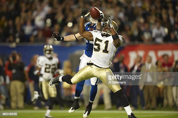 Super Bowl XLIV New Orleans Saints Jonathan Vilma in action defense vs Indianapolis Colts Austin Collie Miami FL 2/7/2010 CREDIT Al Tielemans
