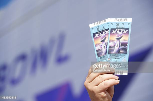 Super Bowl XLIX Closeup of fan holding tickets before New England Patriots vs Seattle Seahawks game at University of Phoenix Stadium Glendale AZ...