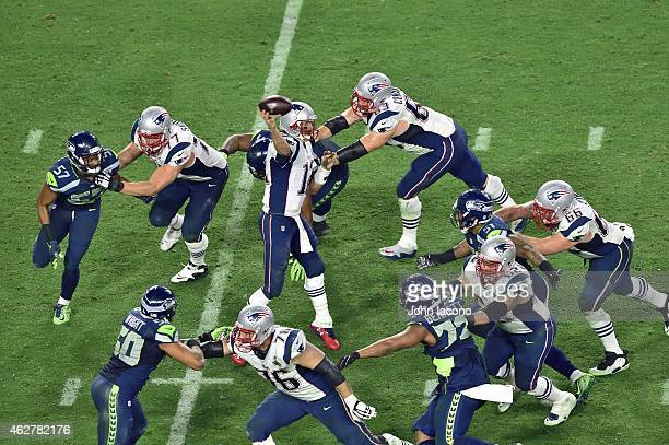 Super Bowl XLIX New England Patriots QB Tom Brady in action pass as offensive line of Nate Solder Dan Connolly Ryan Wendell Sebastian Villmer blocks...