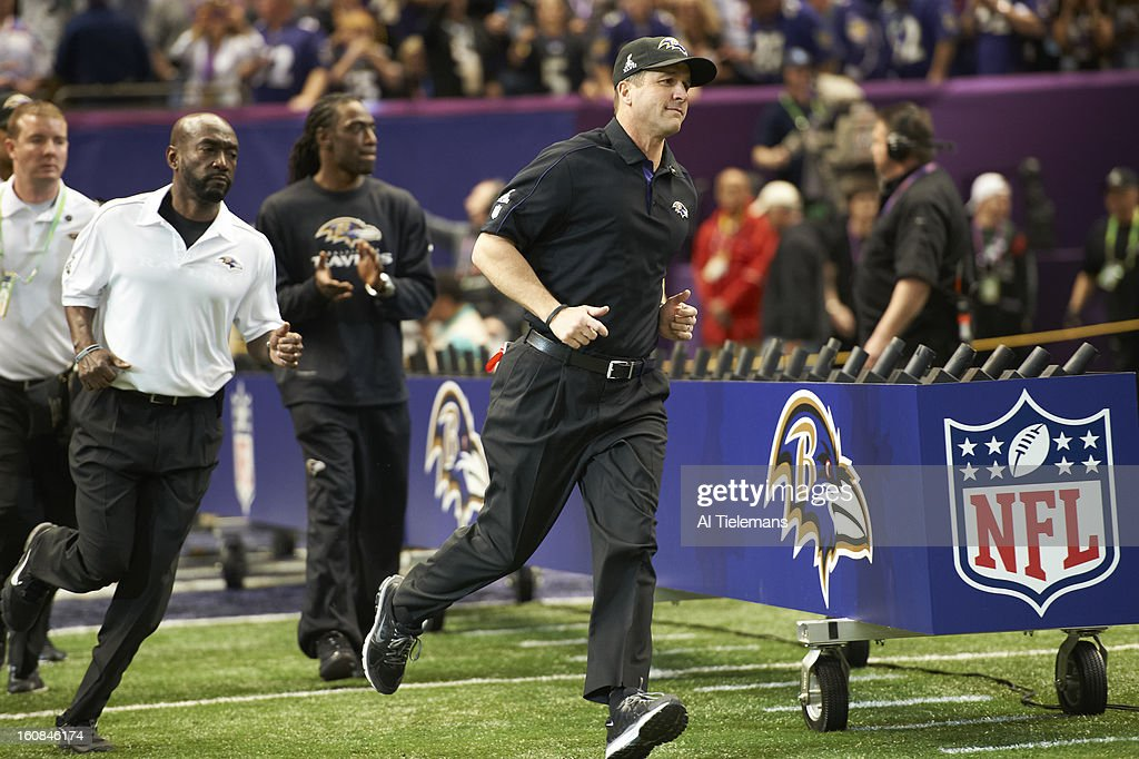 Baltimore Ravens coach John Harbaugh taking field during game vs San Francisco 49ers at Mercedes-Benz Superdome. Al Tielemans F96 )