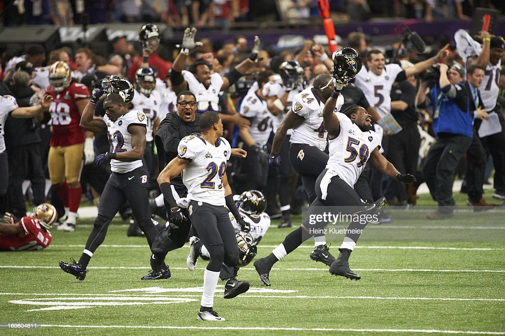 Baltimore Ravens Dannell Ellerbe (59) and Vonta Leach (44) victorious on field with teammates after winning game vs San Francisco 49ers at Mercedes-Benz Superdome. Heinz Kluetmeier F188 )