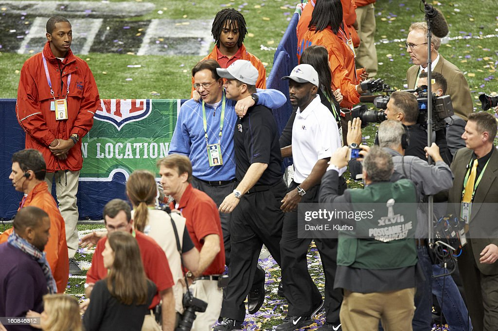 Baltimore Ravens head coach John Harbaugh victorious with his brother-in-law, Indiana University basketball coach Tom Crean, after winning game vs San Francisco 49ers at Mercedes-Benz Superdome. David E. Klutho F127 )