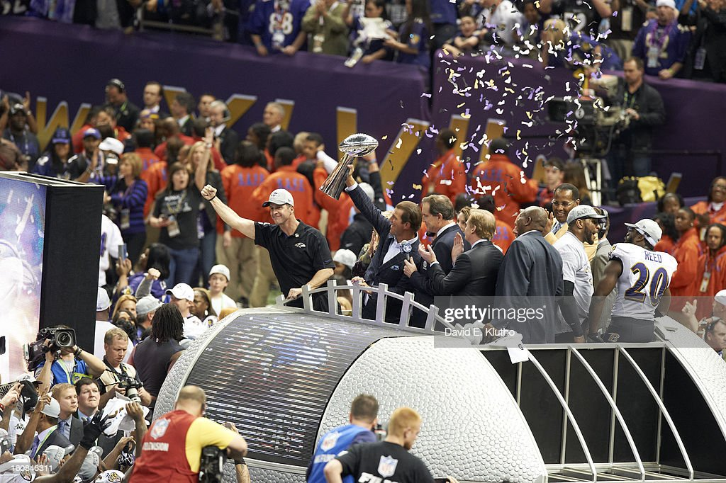 Baltimore Ravens owner Steve Bisciotti and head coach John Harbaugh victorious with Vince Lombardi Trophy after winning game vs San Francisco 49ers at Mercedes-Benz Superdome. David E. Klutho F17 )