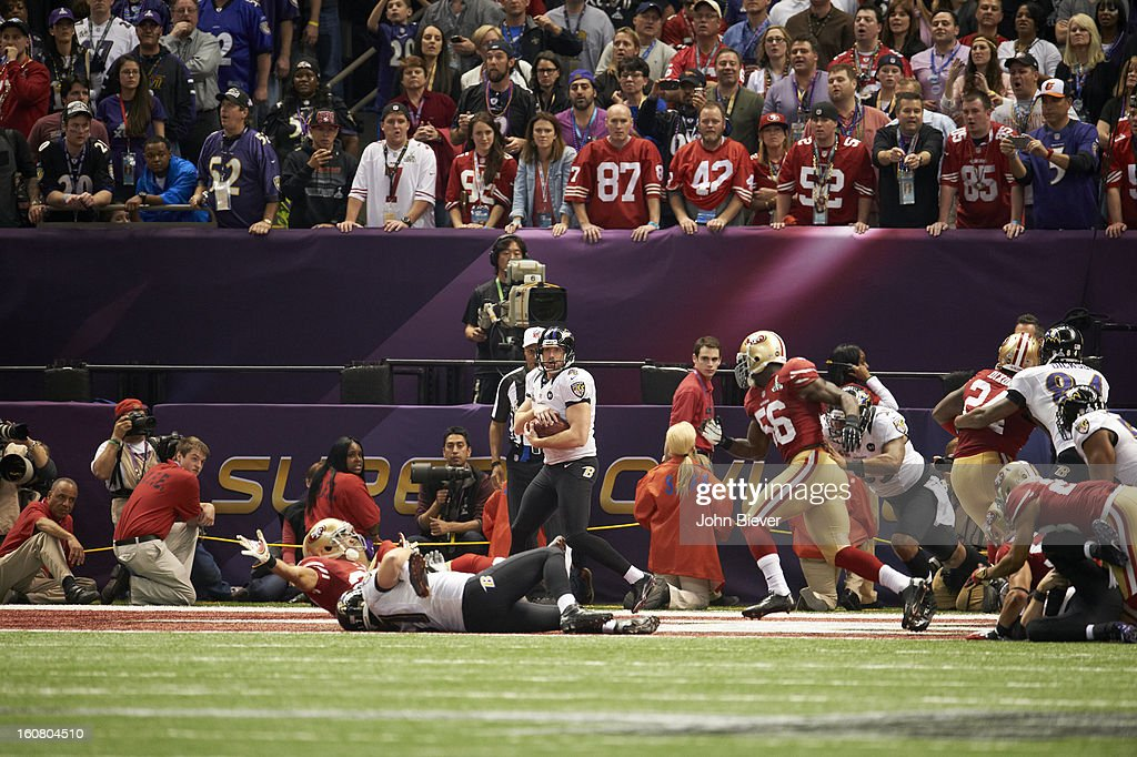 Baltimore Ravens punter Sam Koch (4) in action vs San Francisco 49ers at Mercedes-Benz Superdome. Koch ran out of bounds on a fake punt, taking a safety to run time off of the clock. John Biever F36 )