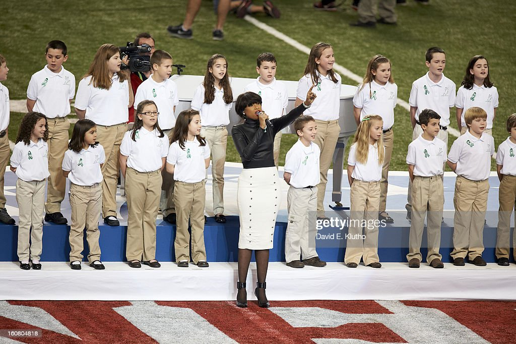 Celebrity singer Jennifer Hudson performing America the Beautiful with 26 students from Sandy Hook Elementary School in Newtown, Connecticut before Baltimore Ravens vs San Francisco 49ers game at Mercedes-Benz Superdome. David E. Klutho F30 )