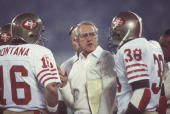 Football Super Bowl XVI San Francisco 49ers coach Bill Walsh with QB Joe Montana and Johnny Davis on sidelines during game vs Cincinnati Bengals...