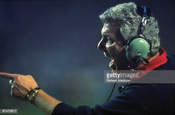 Football Super Bowl XXV Closeup of New York Giants coach Bill Parcells upset with headset during game vs Buffalo Bills Tampa FL 1/27/1991