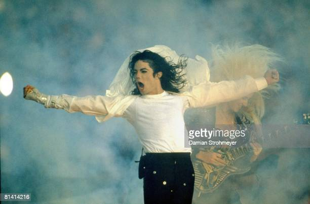 Football Super Bowl XXVII Celebrity singer Michael Jackson performing during halftime of Dallas Cowboys vs Buffalo Bills game Pasadena CA 1/31/1993