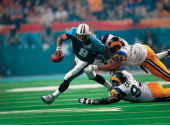 Super Bowl XXXIV Tennessee Titans QB Steve McNair in action avoiding sack by St Louis Rams Jay Williams and Kevin Carter during final minute of play...