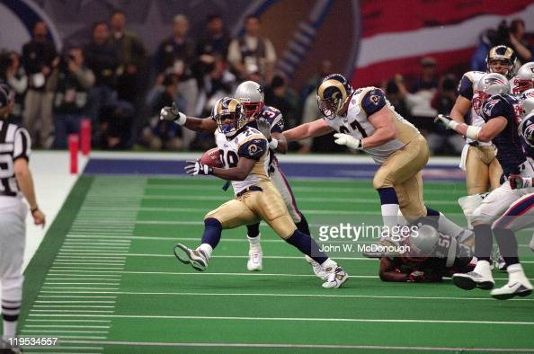 Super Bowl XXXVI St Louis Rams Marshall Faulk in action vs New England Patriots Tebucky Jones at Louisiana Superdome New Orleans LA CREDIT John W...