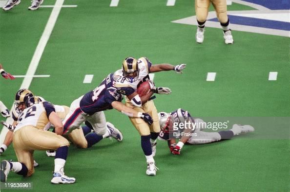 Super Bowl XXXVI St Louis Rams Marshall Faulk in action vs New England Patriots Tedy Bruschi at Louisiana Superdome New Orleans LA CREDIT Bill Frakes