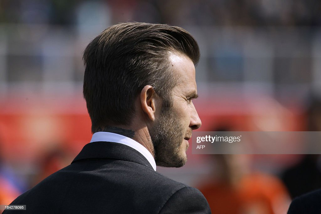 Football superstar David Beckham attends a promotional event in Tiantai Stadium in Qingdao, east China's Shandong province on March 22, 2013. Beckham raised the prospect of one last stop on his global football journey on March 20, refusing to rule out playing in China after his contract with Paris Saint-Germain ends. CHINA