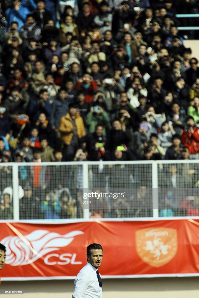 Football superstar David Beckham looks on during a promotional event in Tiantai Stadium in Qingdao, east China's Shandong province on March 22, 2013. Beckham raised the prospect of one last stop on his global football journey, refusing to rule out playing in China after his contract with Paris Saint-Germain ends. CHINA