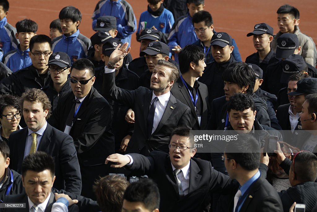 Football superstar David Beckham waves as he arrives for a promotional event in Tiantai Stadium in Qingdao, east China's Shandong province on March 22, 2013. Beckham raised the prospect of one last stop on his global football journey, refusing to rule out playing in China after his contract with Paris Saint-Germain ends. CHINA