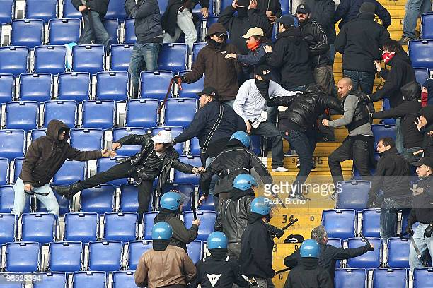 Football supporters and the Police fight in the stands before the Serie A match between SS Lazio and AS Roma at Stadio Olimpico on April 18 2010 in...